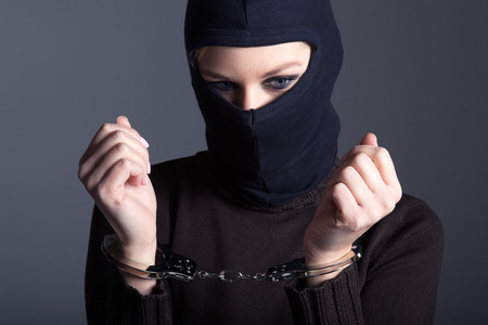 burglar with mask and handcuffs 스톡 콘텐츠
