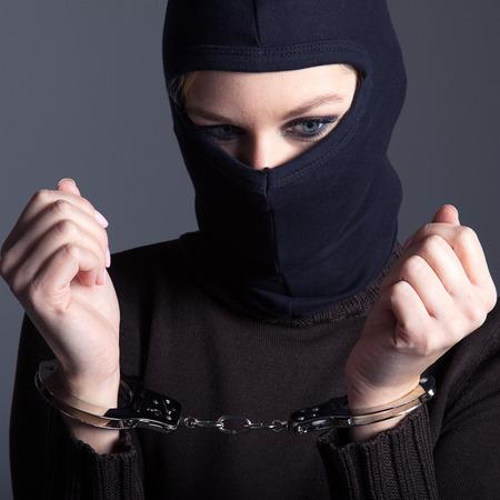 burglar with mask and handcuffs Stock Photo