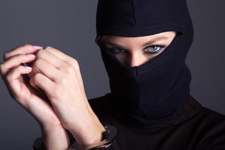 burglar with mask and handcuffs Archivio Fotografico
