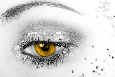beautiful eye with yellow pupil