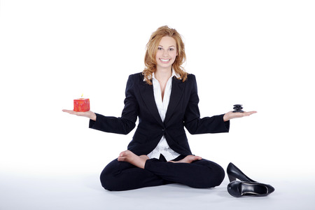businesswoman doing yoga break posing in the studio photo