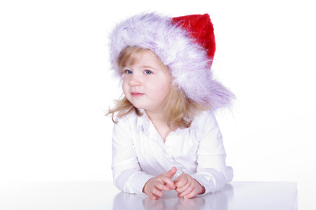 young santa claus girl looks curiously