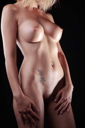 naked female body: Beautiful naked female body on a dark background Stock Photo
