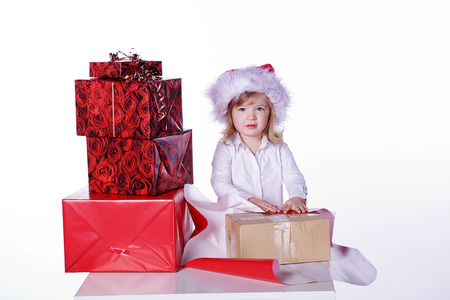 young girl with lots of christmas presents