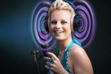 Beautiful woman singing on microphones photo