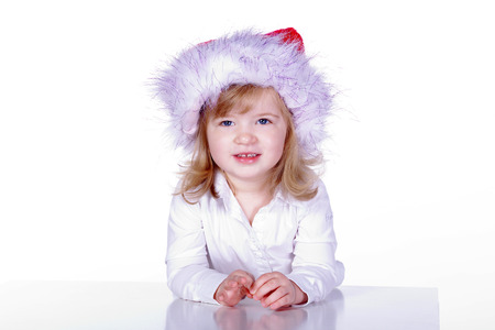 curiously: young santa claus girl looks curiously