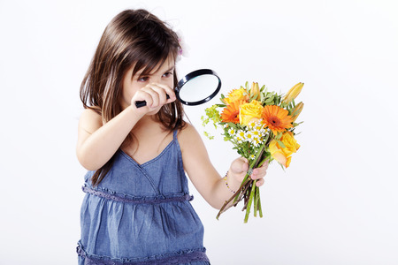 girl with flower and magnifying glass photo