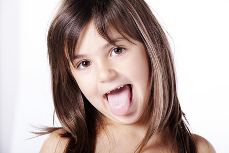 girl tongue: Young girl making grimace with tongue Stock Photo