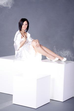 beautiful woman posing on the cube