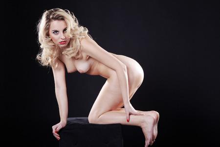 nude female buttocks: Beautiful naked female body on a dark background Stock Photo