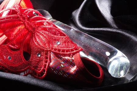 dildo made of glass and red slip 스톡 콘텐츠