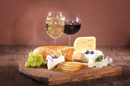 cheese with wine wooden board