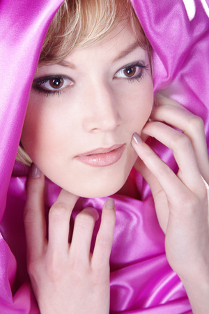 beautiful woman with pink silk scarf