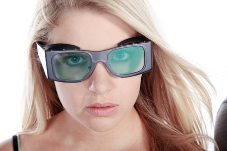 model woman looks with laser safety goggles photo