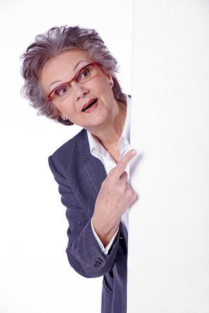 beautiful senior lady with white banner photo