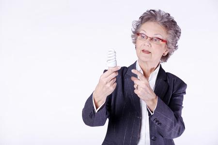 beautiful senior lady with light bulb photo