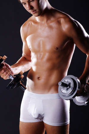 beautiful man in lingerie with dumbbell photo