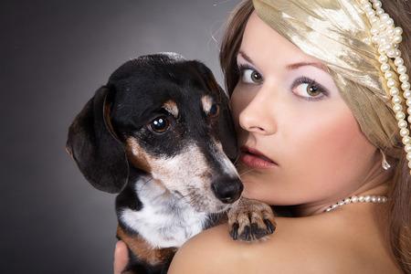 Beautiful woman and dog while cuddling photo