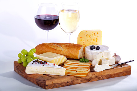 cheese with wine on wooden board
