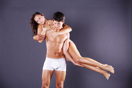 young couple in white lingerie photo