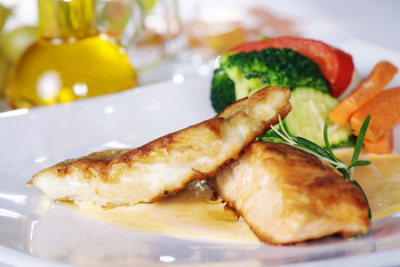 chicken steak with garnish served on dish