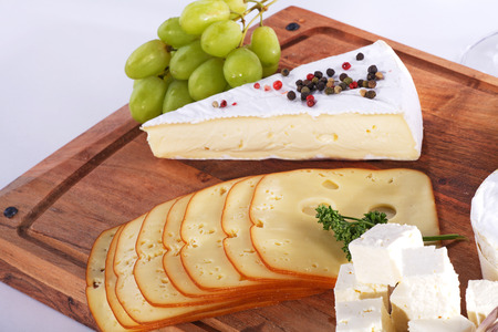 diat product: cheese with wine wooden board
