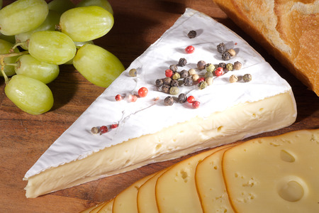diat product: cheese with peppercorns and grapes