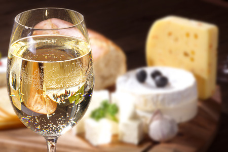 wit: different cheeses present on table wit wine Stock Photo