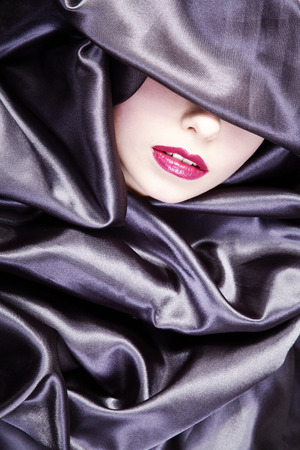 beautiful lips in grey satin Standard-Bild