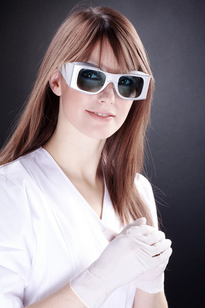 woman as a lab technician with laser safety goggles