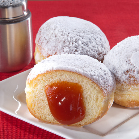 diat product: a jam flows from a donat