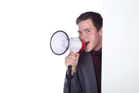 Business man with megaphone on white background photo
