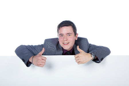 Business man showing thumbs up photo