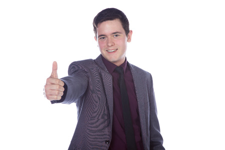 friendly business man showing thumbs up photo