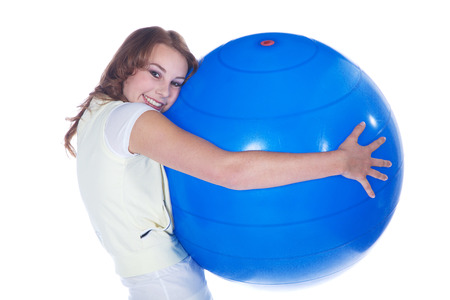 young model makes sport with gym ball photo