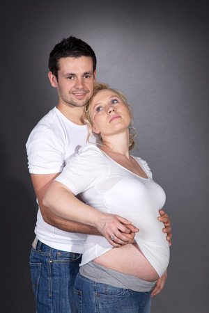 pregnant woman while cuddling with man