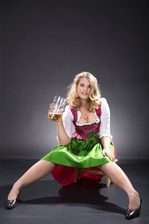 beautiful woman in Bavarian outfit with beer