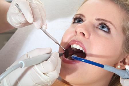 beautiful woman at the dentist visit photo