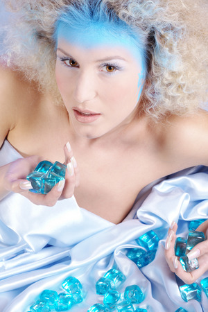 ice queen lying down with ice cubes