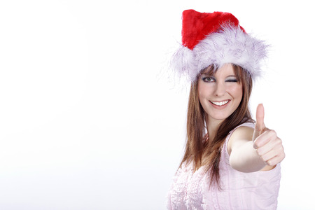 thump: woman with Christmas hat and thump up Stock Photo