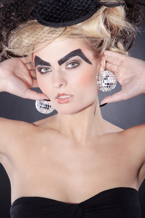 beautiful burlesque woman with disco balls