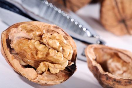 nutty: walnut shell opened with nutcracker