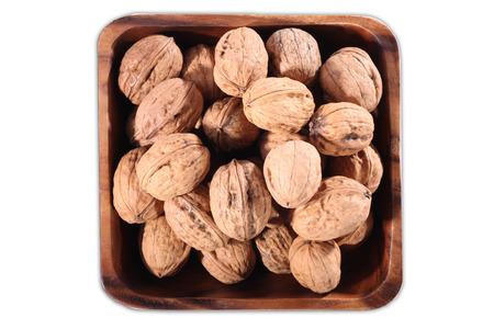 nutty: many walnuts in a brown bowlwalnut Stock Photo