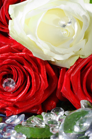 margerite: red and yellow rose decorated with rhinestones Stock Photo