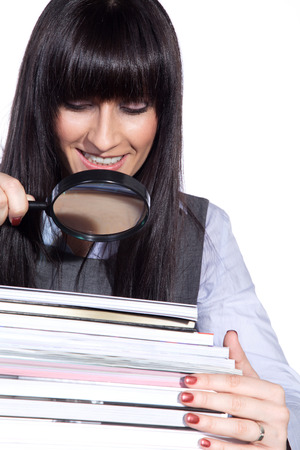 Woman with magnifying glass and folders photo