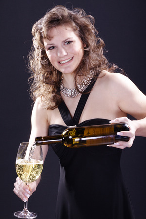 Beautiful woman drinking a glass of wine