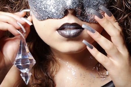 rhinestone: beautiful woman with silver rhinestone mask