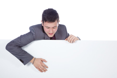 Business man looks on white background photo