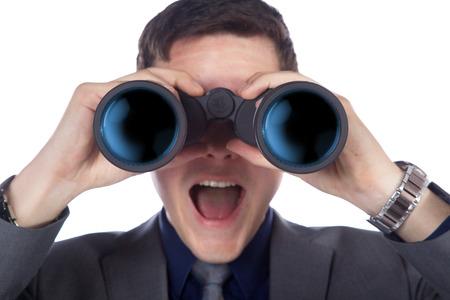business man looking through binoculars photo