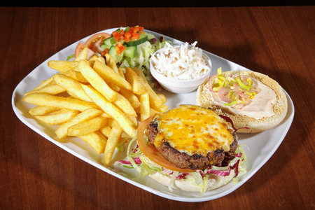 diat product: Hamburger with french menu on white plate Stock Photo